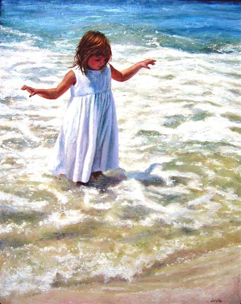 A young girl, in a white dress, frolics in the ocean surf.